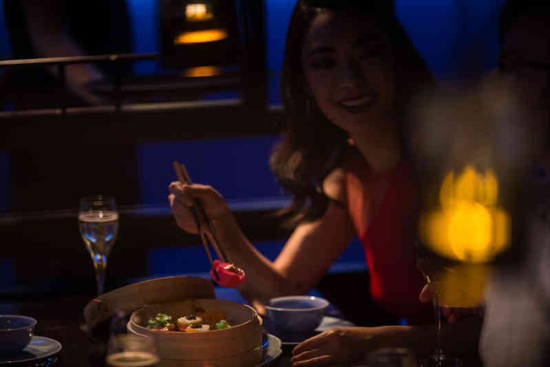 Woman eating a dim sum platter