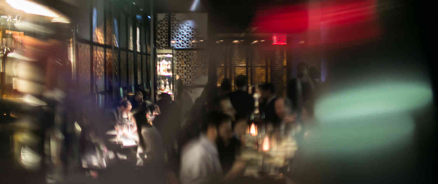 Cinematic picture of people dining in Hakkasan New York