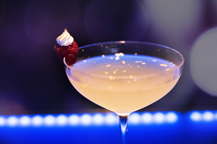 Cocktail with gold flakes in it