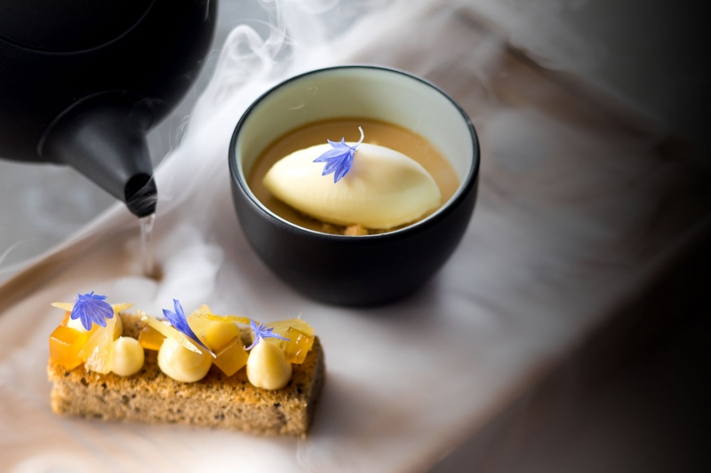 Pastry with a cup of smoky tea and ice cream