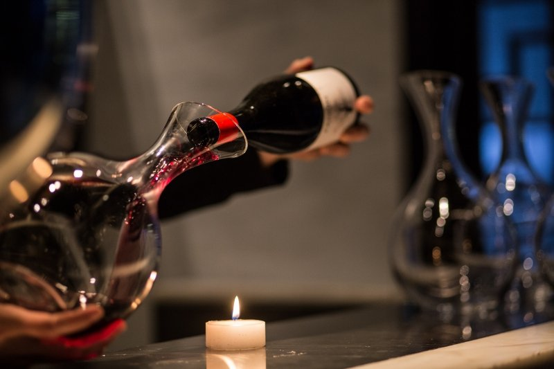 Server pouring red wine