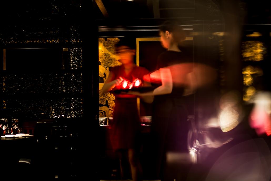 Servers holding candles at Hakkasan Hanway Place