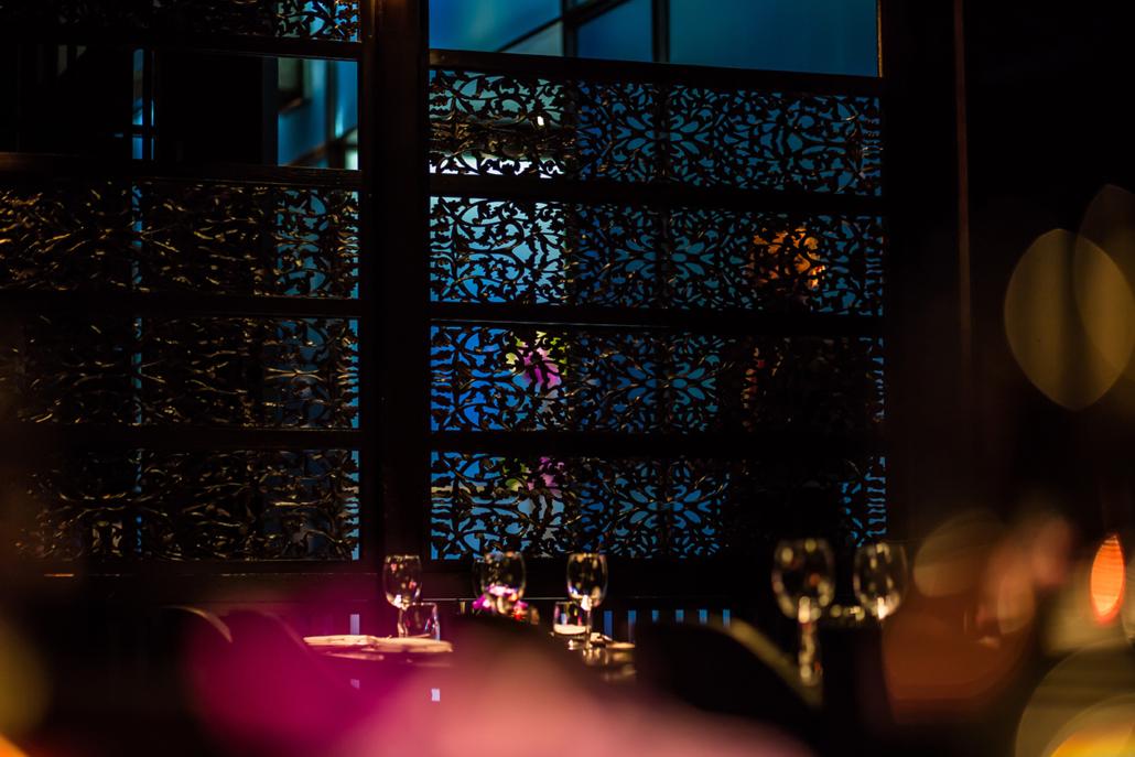 Hakkasan dining room with latticework background